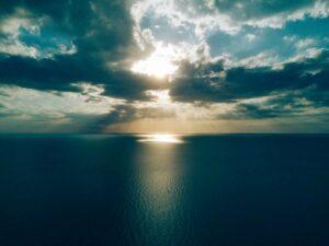 Sunrise sunset over ocean