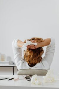 Woman stressed with tissue in hand