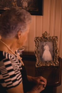 woman looking at wedding photo