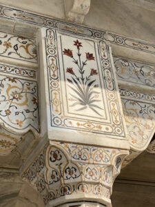 Jewel inlaid into building structure