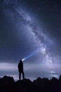 man looks at sky