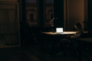 Man in dark with computer